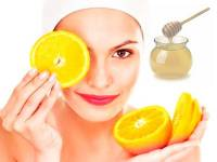 A radiant face with oranges